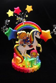 This is a personalized Rainbow Brite Cake topper/centerpiece. Everything is hand made and painted. This topper will include the name of the birthday girl. This is a wonderful piece to make your cake s