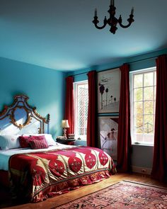 elegance classic blue bedroom design with red curtain window as well white gold headboard and rug on wooden floor plus lamp table corner