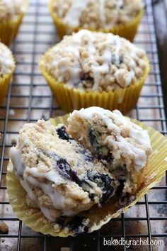Moist blueberry streusel muffins with a sweet vanilla glaze. Recipe from @bakedbyrachel