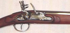 This is a beautiful musket with all iron hardware and octagon to round barrel, with two wedding bands. The stock on this musket has been cut back to accommodate a socket bayonet, however, our production models are full stocked to the muzzle, (like the originals), and will only accept a plug bayonet, unless the customer desires to cut  the stock back themselves.  Ram rod is wood, and there are no sling swivels.