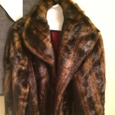 faux fur coat. brand new never worn! long brown faux fur coat. perfect for the winter season and totally on trend. Jackets & Coats