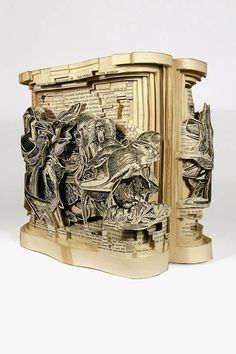 This combines two of my favorite things, art and books. Book surgeon Brian Dettmer carves books into unique works of art.