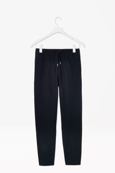 TWILL DRAWSTRING TROUSERS  Made from soft cotton twill, these trousers have a elasticated waistband and comfortable drawstring fastening. A relaxed fit that taper towards the ankle, they have pockets at the sides and back.