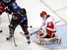 Colorado's Peter Forsberg can't get the puck past Detroit goalie Chris Osgood. Detroit Red Wings, Peter Forsberg, Red Wings Hockey, Colorado Avalanche, Ice Hockey, Nhl, Lions, Muscle, Baby