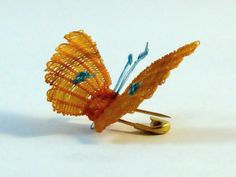 Mariposas 2 cm. de varios colores con prendedor