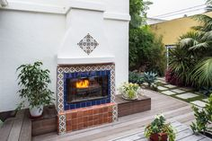MEXICAN FIREPLACE Design Ideas. I absolutely love patio fireplaces. Love the Mexican tile with Adobe.