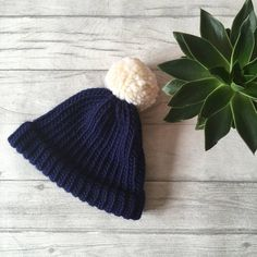 c63cb3ddedfe2 Blue and white knitted hat