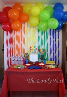 Rainbow Crepe Streamers and Balloons. Birthday Direct has awesome colors and cheap prices here to mimic this look: http://www.birthdaydirect.com/solid-color-crepe-paper-streamers-c-45_209.html http://www.birthdaydirect.com/solid-color-latex-balloons-c-252_239.html