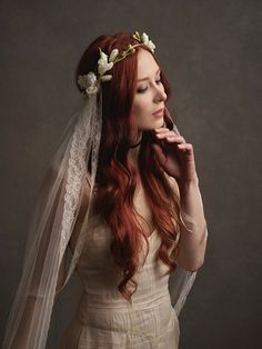 This is Louisa, a veil reminiscent of bygone eras. The veil is a soft ivory vintage veiling which has found a new life attached to a crown of flowers. Its very long and trails on the ground as you walk with vintage lace ribbons adorning each side. The circlet features ivory blossoms, floral buds, dried looking roses, and a pale magnolia.  -- full circlet crown -- cathedral length veil (available in different lengths/colors) -- fits 22 heads (can be made to your measurement per request) -...