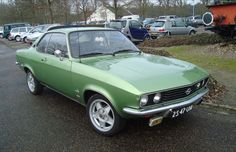 Opel Manta in silvered green with custom wheels...mine was gray and with a black roof ...cool car,
