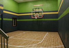 high ceiling in the basement. The floor of the court is another level down from the basement floor level allowing the required size despite a tight building envelope. Basketball Room, Outdoor Basketball Court, Basketball Tricks, Basketball Scoreboard, Basketball Goals, Illini Basketball, Backyard Basketball, Basketball Stuff, Basketball Information