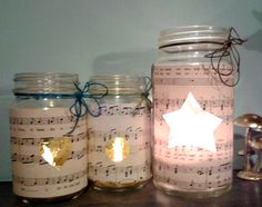 old kilner jars and music sheets...shapes cut out and candles lit...