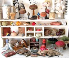 My friend, Jacqueline would love this pincushion display, but really, who has the room?