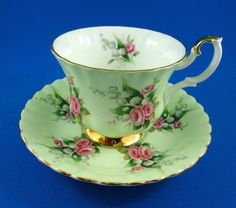 Royal Albert Lily of the Valley and Roses on Mint Green Teacup & Saucer.