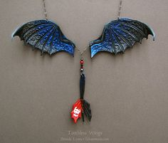 This Lovely Necklace Features The Wings And Tail Of Toothless Read more at http://fashionablygeek.com/jewelry/this-lovely-necklace-features-the-wings-and-tail-of-toothless/#beV7Sri56TrP58Le.99