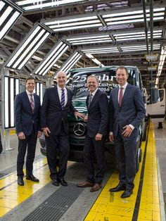 """The Mercedes-Benz Vans plant in Ludwigsfelde is turning 25! From left: Sebastian Streuff, plant manager and CEO at Mercedes-Benz Ludwigsfelde GmbH, Dr Dietmar Woidke, first minister of the state of Brandenburg, Volker Mornhinweg, Head of Mercedes-Benz Vans, and Frank Klein, Head of Operations Mercedes-Benz Vans, welcome a new """"open"""" Sprinter at the end of the production line at the anniversary event."""
