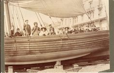 Group portrait in a beach-launched pleasure yacht, possibly the 'New Albertine', in front of the Queens Hotel, Hastings by William Smith (1910) par pellethepoet