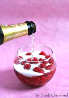 Raspberry & Honey Bellini - Beautiful holiday drink! Try making this little aperitif with a St. James Winery Island Getaway--or maybe even experiment by using half Raspberry and half sparkling!
