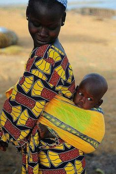An African mother from Mali looks back adoringly at her beloved son. ------ (Photo by Luca Gargano)