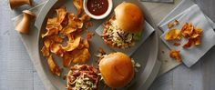 Perfect for a crowd, this moist pulled pork, slow cooked with Progresso™ chicken broth, cider vinegar and barbecue sauce, is topped with a crunchy slaw for an easy dish that will help both your kitchen and you keep your cool.