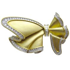 Impressive Bow Tie Diamond Brooch   From a unique collection of vintage brooches at https://www.1stdibs.com/jewelry/brooches/brooches/