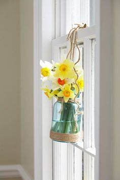 A vintage bell jar bouquet is a sweet reminder that spring is here.