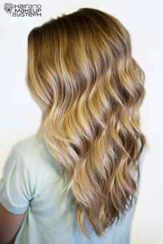 Tutorial: Using a curling wand to get simple beachy waves. Everyone always asks sheryl at the front desk how she does it, well, here is a step by step :)