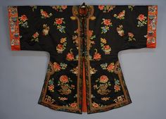 Chinese embroidered surcoat, mid 20th c. Navy satin with satin and seed stitch embroidered floral urns, cinnamon sleeve bands with potted flowers, brass buttons with silk loops, lined in red silk