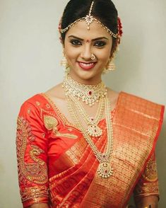 South Indian bride. Diamond Indian bridal jewelry.Temple jewelry. Jhumkis.Red silk kanchipuram sari.Braid with fresh jasmine flowers. Tamil bride. Telugu bride. Kannada bride. Hindu bride. Malayalee bride.Kerala bride.South Indian wedding.