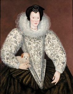 English: Portrait of a lady wearing a white bodice and sleeves embroidered with flowers and figures hunting, with a dark petticoat and a ruff, holding a small dog. Circle of Marcus Gheeraerts the Younger (1561–1636)