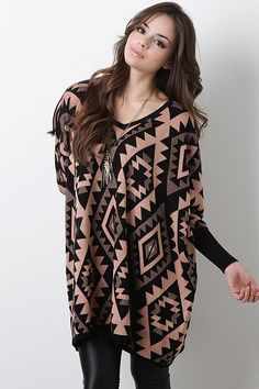 Connect with your free spirited side with this Indian Trails Sweater Tunic. This comfy knit tunic can be worn as you please, with its contrasting tribal print patterns, long dolman sleeves, and v-neckline