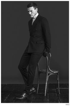 Promoting his latest movie Dracula Untold, actor Luke Evans appears in a new photo shoot for WWD. Donning fall styles from labels such as Valentino and Mul