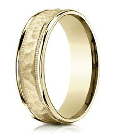 Designer Men's 14K Yellow Gold Ring With Hammered Center - Mixed surfaces make for an utterly captivating 14K designer men's yellow gold ring. Equally suitable as a men's fashion ring or contemporary wedding band, a hammered center is framed by milgrain beading. High polished edges complete this 6mm comfort fit band. To learn more visit - http://www.justmensrings.com/Designer-Mens-14K-Yellow-Gold-Ring-With-Hammered-Center-6mm_p_1346.html