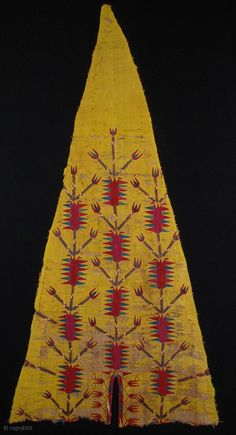 Side section fragment of an early Turkmen chyrpy, 85 x 40 cms, distressed but the embroidery is in good condition, beautifully and spaciously drawn with superb colours, mounted on black fabric.