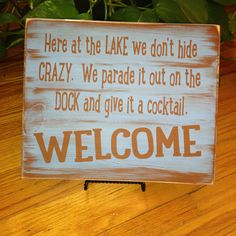 Here at the LAKE we don't hide CRAZY, we parade it out on the DOCK and give it a Cocktail!  Welcome! Fun for the Lake house, the Cabin!! by AmysSillySigns on Etsy https://www.etsy.com/listing/232462725/here-at-the-lake-we-dont-hide-crazy-we