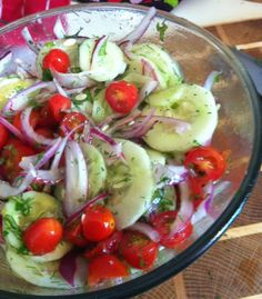 Cucumber Tomato Salad  Ingredients    2 cucumbers, thinly sliced  1 pint cherry tomatoes, halved  1/2 large red onion, thinly sliced  1/4 cup fresh basil, chopped  2 T fresh parsley, chopped       1/4 cup extra virgin olive oil  3/4 cup apple cider vinegar  1/2 T red wine vinegar  1/8 cup fresh dill, chopped   1 tsp sugar  S