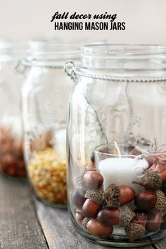 Inexpensive Pottery Barn Hack!  Using hanging mason jars and fillers, you can create fabulous fall decor in minutes! #masonjars #diy