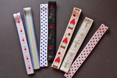 Now I know how to recycle all those business card magnets...magnetic bookmarks with ribbon