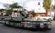 """'Raul Lemesoff, an Argentine art-car artist, has taken a 1979 Ford Falcon that used to belong to the Argentine armed forces and turned into a 'Weapon of Mass Instruction.Armed with 900 or so books Lemesoff travels the streets of Buenos Aires and beyond offering free books to all. He sees his 'Weapon of Mass Instruction' as a """"contribution to peace through literature."""""""