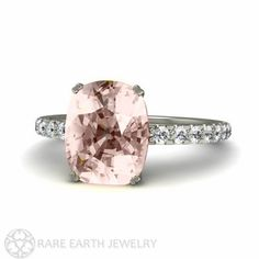 An absolutely lovely natural Morganite and diamond ring in Platinum. The center stone is a lovely cushion cut Morganite of approximately 2.6 carats in