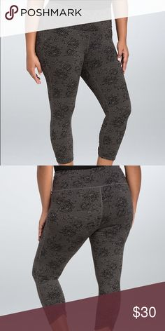 """Torrid Active - Lace Print Crop Leggings """"These grey and black lace print leggings lend sophistication to your workout-wear. The 4-way stretch forms to your figure comfortably, while the cinched back leg and tummy smoothing waistband add flattering detail. Wicking technology keeps you cool and dry. A discreet waistband pocket is the perfect size for a car key. 21"""" inseam. Nylon/spandex."""" New with tags, size 2X. torrid Pants Leggings"""