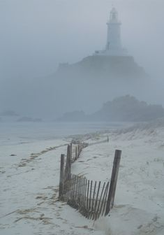 I think it is a lighthouse - Love the misty beach.