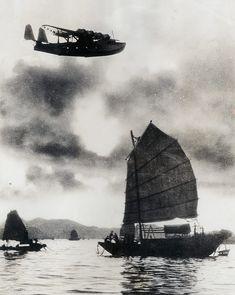 Pan Am's China Clipper soars over an old Chinese junk near Hong Kong Harbor, 1937 (International News Photo) Hong Kong, National Airlines, Photos Originales, Pan Am, Flying Boat, Pilot, Aviation Art, Aviation Industry, Air Travel