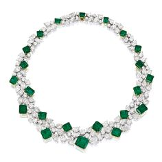 EMERALD AND DIAMOND NECKLACE The bib necklace composed of twenty-two step-cut emeralds, the five largest emeralds together weighing 22.86 carats, the remaining seventeen emeralds together weighing approximately 34.90 carats, interspersed by pear-shaped and brilliant-cut diamonds together weighing approximately 78.13 carats, mounted in 18 karat white and yellow gold, length approximately 410mm.