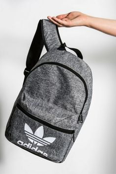 Back to school doesn't have to be boring, we've got you covered with this grey adidas backpack