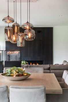 The LuxPad spoke to some interior experts to provide you with a wealth of inspiring kitchen lighting ideas to illuminate your kitchen in style. 13 Lustrous Kitchen Lighting Ideas to Illuminate Your Home Dining Room Lamps, Dining Room Sets, Dining Room Design, Wall Lamps, Kitchen Design, Lights Over Dining Table, Dining Room Ceiling Lights, Lights For Living Room, Dining Room Feature Wall