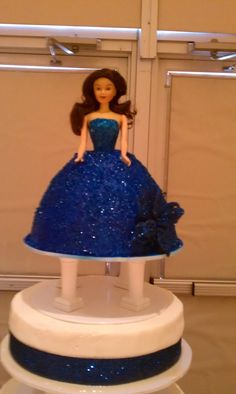 top tier doll on quinceanera cake