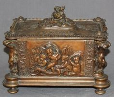 Antique French copper relief dresser box with cherubs frolicking. 19th century.