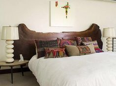 The cushions, lamps and art just all works with the shape and colour of the headboard