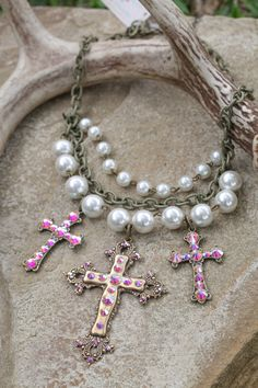 This triple cross, pearl necklace is guaranteed to be a hit in your boutique!   Item # J-141BP